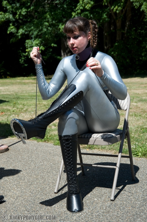 Anna Rose lacing up her pony boots